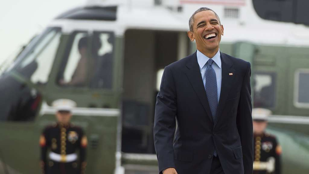 TOPSHOTSUS President Barack Obama laughs as he walks from Marine One to board Air Force One prior to departing from Andrews Air Force Base in Maryland, November 2, 2015. Obama is traveling to Newark, New Jersey to speak about the re-entry process for formerly incarcerated individuals and New York City to attend Democratic fundraisers. AFP PHOTO / SAUL LOEB