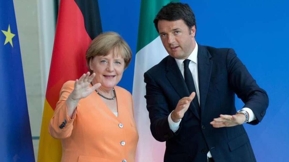 Bundeskanzlerin Angela Merkel und Italiens Ministerpräsident Matteo Renzi sprechen in Berlin unter anderem über die Flüchtlingskrise. Foto:Jörg Carstensen/Archiv