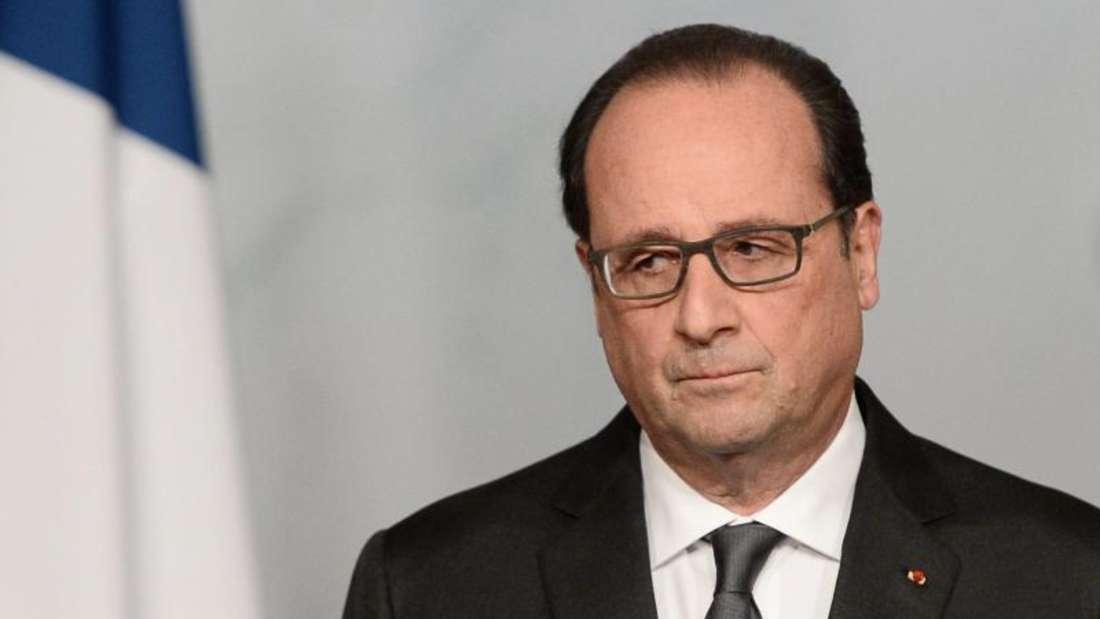 Frankreichs Präsident Hollande hat eine verurteilte Mörderin begnadigt. Die66-Jährige hatte nach 47 Jahren Ehe-Hölle ihren Mann im September 2012 mit drei Schüssen in den Rücken getötet. Foto: Stephane De Sakutin