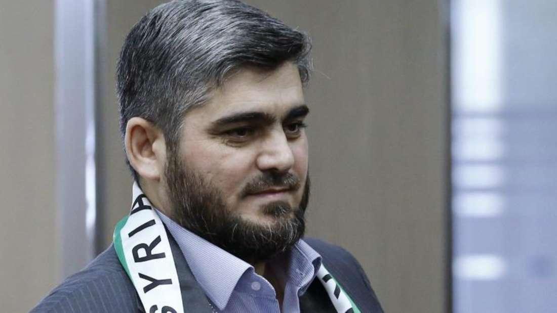 Mohammed Allusch, Führungsmitglied der Rebellengruppe Dschaisch al-Islam, begründet seinen Rücktritt mit der Kompromisslosigkeit des syrischen Regimes und den fortgesetzten Angriffen gegen Zivilisten. Foto: Denis Balibouse