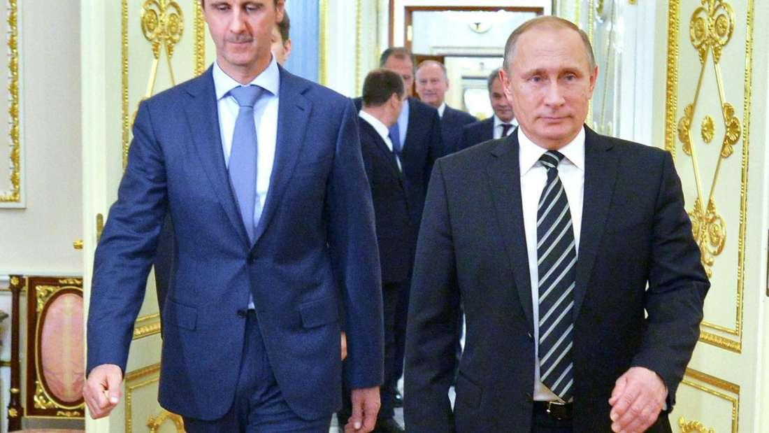Putin (re.) schützt Assad undlehnt UN-Sanktionen wegen Giftgas-Angriffen in Syrien ab.