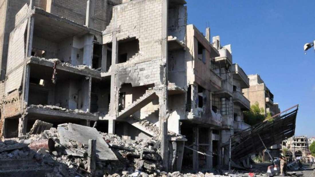 Zerstörte Gebäude in Bab Tadmour, einem Stadtteil von Homs. Foto: Sana