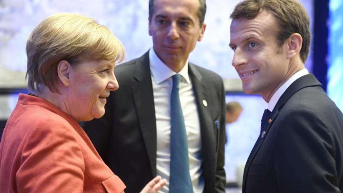 Bundeskanzlerin Angela Merkel, der österreichische Bundeskanzler Christian Kern (M.) und der französische Präsident Emmanuel Macron beim EU-Gipfel in Tallinn. Foto: Heikki Saukkomaa