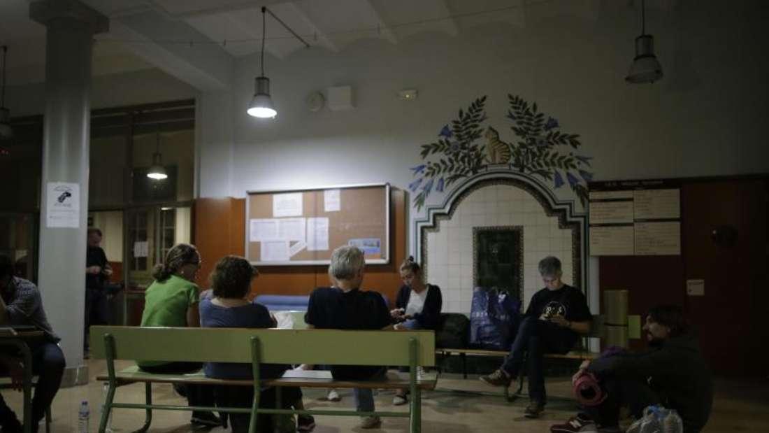 Bürgerkomitees, die sich für die Durchführung der Volksabstimmung einsetzen, forderten die Bevölkerung auf, Schulen und andere Gebäude zu besetzen, die als Wahllokale dienen sollen. Foto: Manu Fernandez