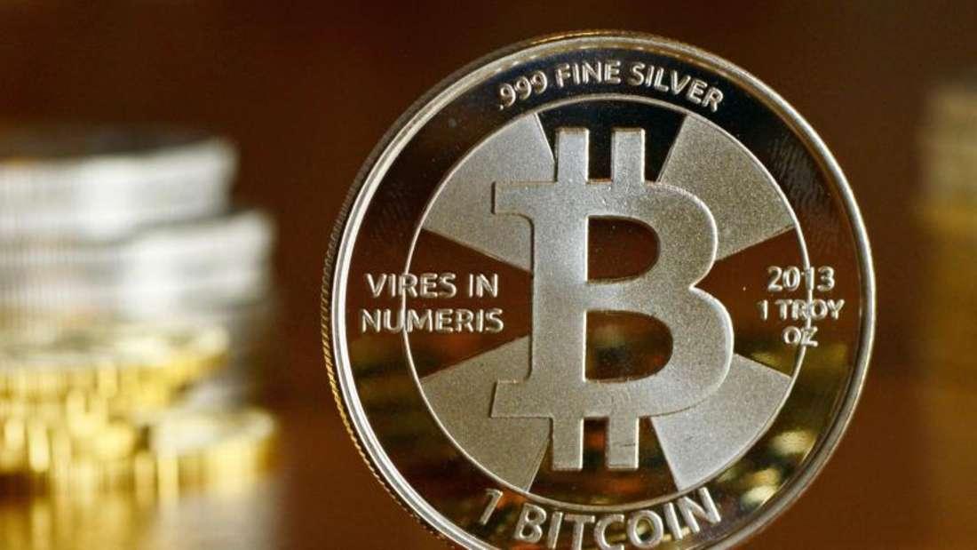 Starke Kursschwankungen:Als Geldanlage ist die virtuelle Währung Bitcoin nur bedingt geeignet. Foto: Jens Kalaene