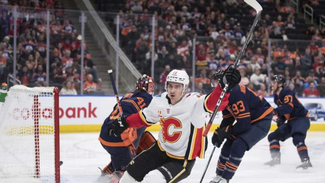 Mikael Backl von den Calgary Flames jubelt nach einem Treffer gegen die Edmonton Oilers. Foto: Darryl Dyck/The Canadian Press/dpa