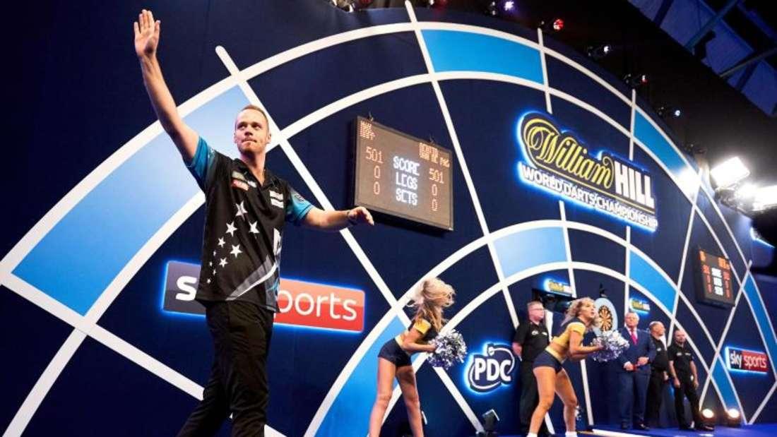Max Hopp würde Darts gerne im Programm der Olympischen Spiele sehen. Foto: John Walton/PA Wire/dpa
