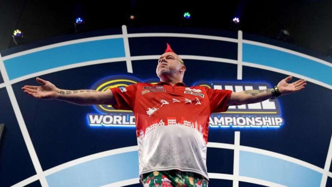 Will bei der Darts-WM ins Halbfinale: Peter Wright. Foto: John Walton/PA Wire/dpa