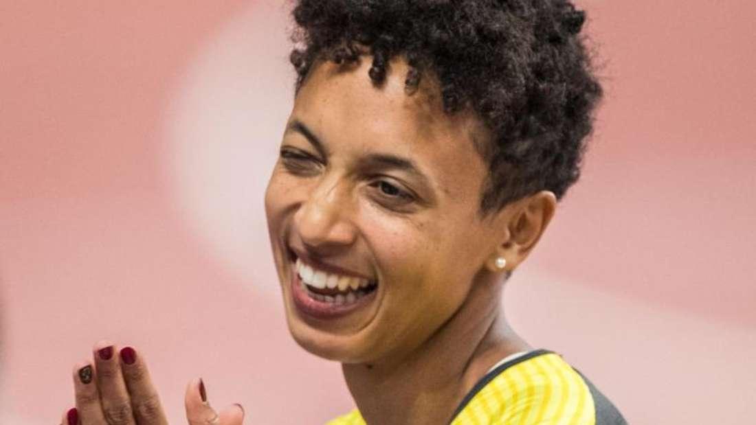 Favoritin Malaika Mihambo gewann bei der WM in Doha Gold im Weitsprung. Foto: Oliver Weiken/dpa