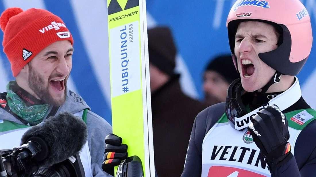 Springen in Garmisch: Karl Geiger (rechts) jubelt nach seinem Sprung im 2. Durchgang, sein Team- und Zimmerkollege Markus Eisenbichler (links) feiert mit.